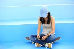 Skateboarder listening music stock images