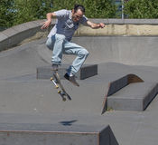 Skateboarder performing a kickflip Royalty Free Stock Images