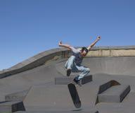 Skateboarder performing a kickflip Stock Photos