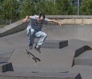 Skateboarder performing a kickflip Stock Image