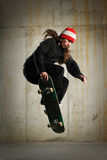 Skateboarder performing tricks Stock Photos