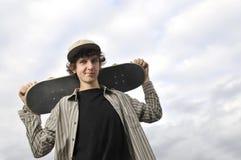 Skateboarder portrait. Happy skate boarder outdoor portrait stock photo