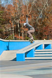 Skateboarder Practices Trick At New Skateboard Park Royalty Free Stock Images