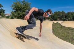 Skateboarder on a pump track park Stock Photos
