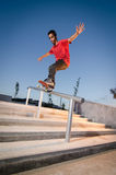 Skateboarder on rail Royalty Free Stock Images