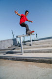 Skateboarder on rail Stock Image