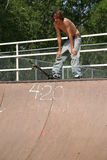Skateboarder at ramp top Royalty Free Stock Photography