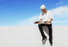 Skateboarder relaxes Stock Photography