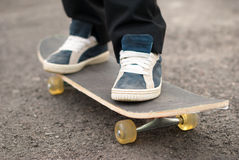Skateboarder rides on the board. Royalty Free Stock Images