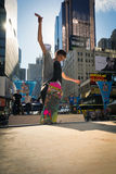 Skateboarder rides a halfpipe in Times Square in New York City Royalty Free Stock Image