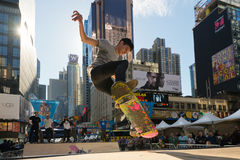 Skateboarder rides a halfpipe in Times Square in New York City Stock Images