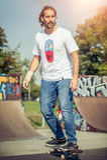 Skateboarder riding in skate park Stock Photo