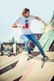 Skateboarder riding in skate park Royalty Free Stock Image