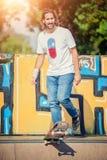 Skateboarder riding in skate park Stock Photos