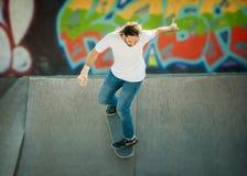 Skateboarder riding in skate park Stock Photography