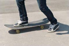 Skateboarder riding a skateboard Royalty Free Stock Image