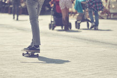 Skateboarder Riding Skateboard at City Street Pavement Royalty Free Stock Photos