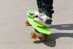 Skateboarder riding a skateboard. Stock Photo