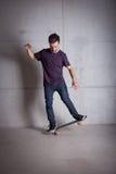 Skateboarder riding skateboard Stock Image