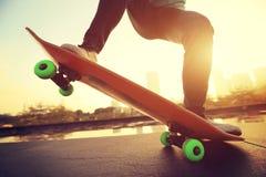 Skateboarder riding on skateboard Royalty Free Stock Images