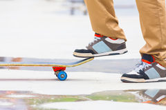 Skateboarder riding a skateboard on the street or park Stock Photography