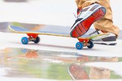 Skateboarder riding a skateboard on the street or park Stock Photos