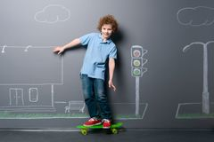 Skateboarder riding on the street royalty free stock photography
