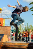 Skateboarder shows skill on extreme competition Stock Photos