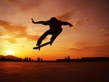 Skateboarder Silhouette. Skateboarding at sunset beautiful scene Stock Photography