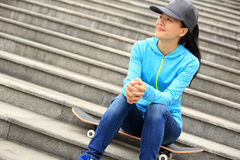 Skateboarder sit on stairs Royalty Free Stock Photography