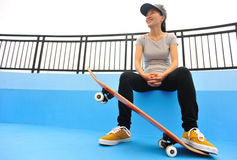 Skateboarder sit on stairs Royalty Free Stock Image