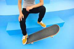 Skateboarder sit on stairs Stock Images
