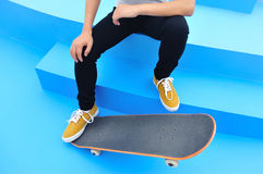 Skateboarder sit on stairs Stock Photo