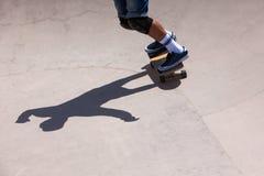 Skateboarder in skate park Royalty Free Stock Photo