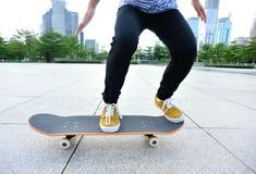Skateboarder skateboarding at city Stock Photos