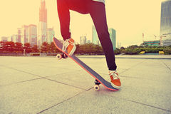 Skateboarder skateboarding at city Royalty Free Stock Photo