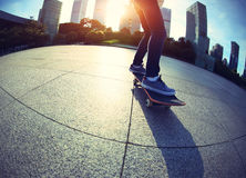 Skateboarder skateboarding at city Stock Photography