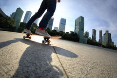 Skateboarder skateboarding at city Royalty Free Stock Photos