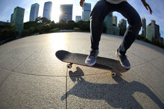 Skateboarder skateboarding at city Stock Images