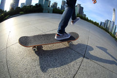 Skateboarder skateboarding at city Royalty Free Stock Photography