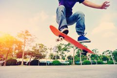 Skateboarder skateboarding at city Stock Photo