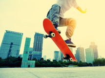 Skateboarder skateboarding at city Royalty Free Stock Image
