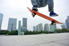 Skateboarder skateboarding at city Stock Images