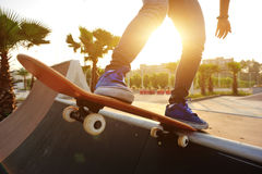 Skateboarder skateboarding at city Stock Photos