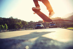 Skateboarder skateboarding at city Royalty Free Stock Images