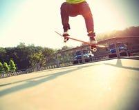 Skateboarder skateboarding at city Royalty Free Stock Photos