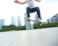 Skateboarder skateboarding at city Stock Image
