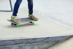 Skateboarder skateboarding on a skateboard Royalty Free Stock Image