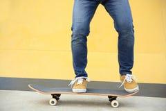 Skateboarder skateboarding at skatepark Stock Image