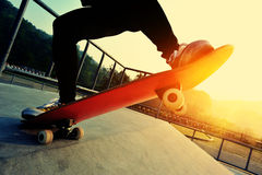 Skateboarder skateboarding at skatepark Royalty Free Stock Images